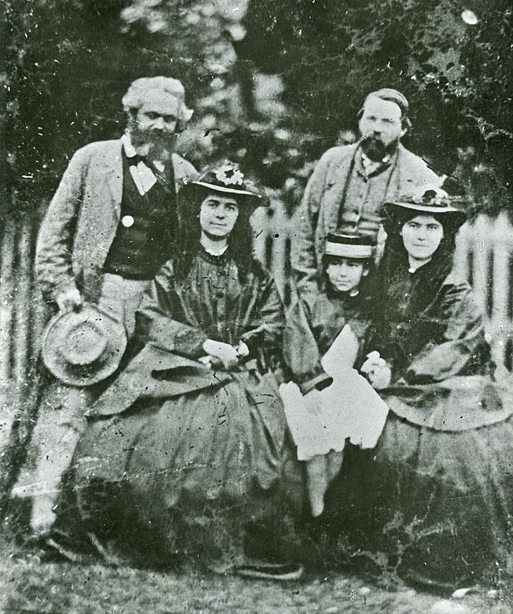 family portrait with Karl Marx with Friedrich Engels and Marx's daughters - Jenny Caroline, Jenny Julia Eleanor, and Jenny Laura
